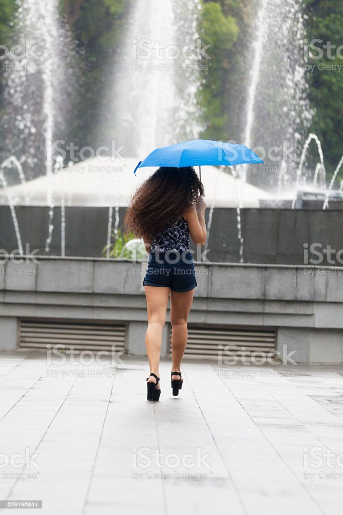 Young woman with blue umbrella stock photo