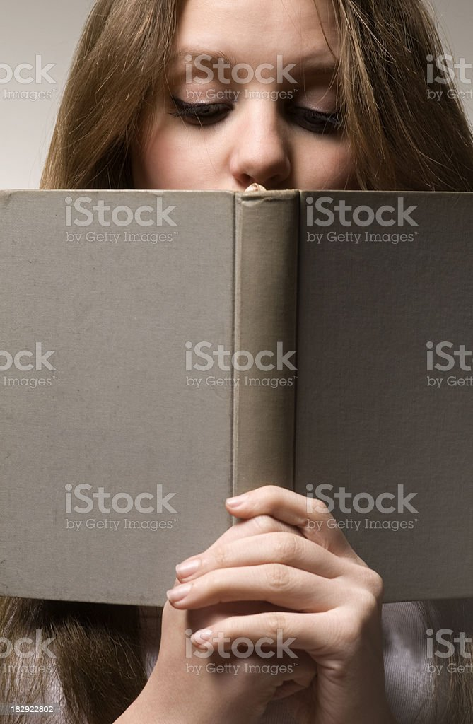 Young woman with book royalty-free stock photo