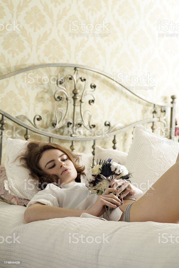 young woman with   bouquet  flowers royalty-free stock photo