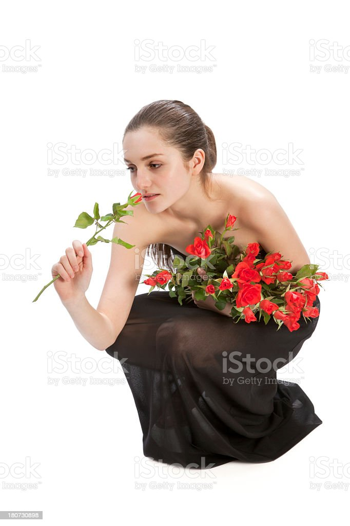 Young woman with bouquet of red roses royalty-free stock photo