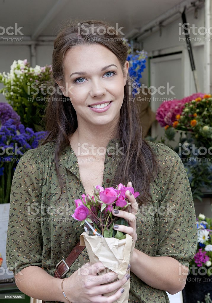 young woman with bouquet of roses at flower market royalty-free stock photo