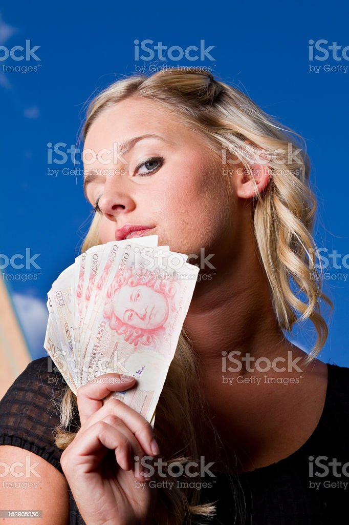 Young Woman with British Pounds and Euros royalty-free stock photo