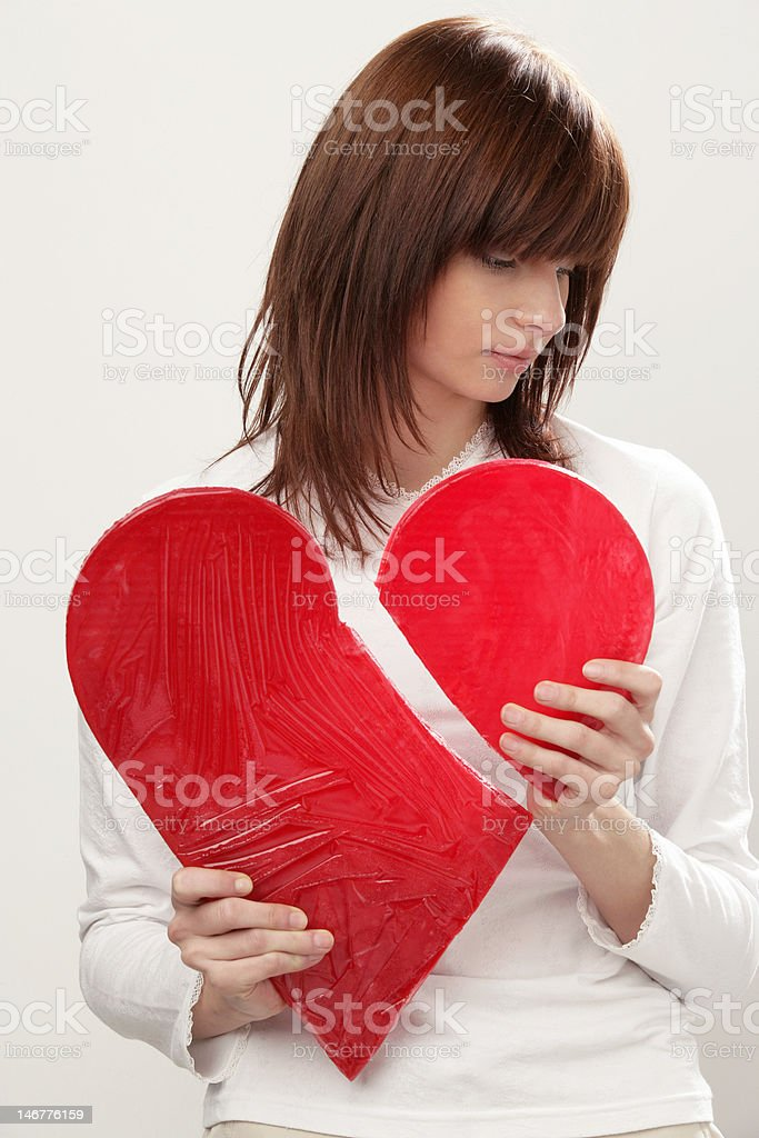 Young woman with broken heart royalty-free stock photo