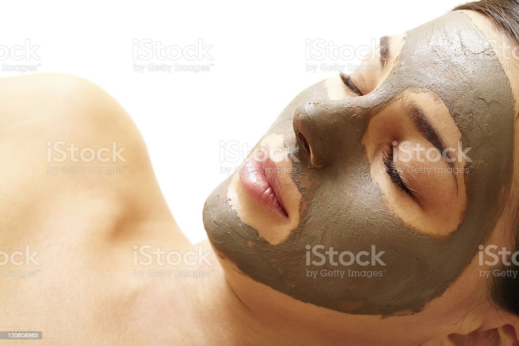 Young woman with brown facial mask stock photo