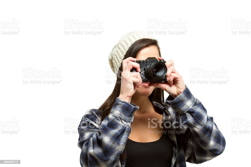 Young woman with brown hair taking a photo stock photo