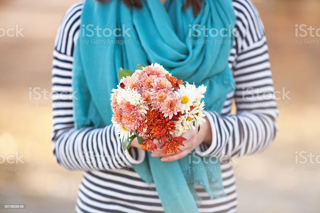 Young woman with bunch of wildflowers stock photo