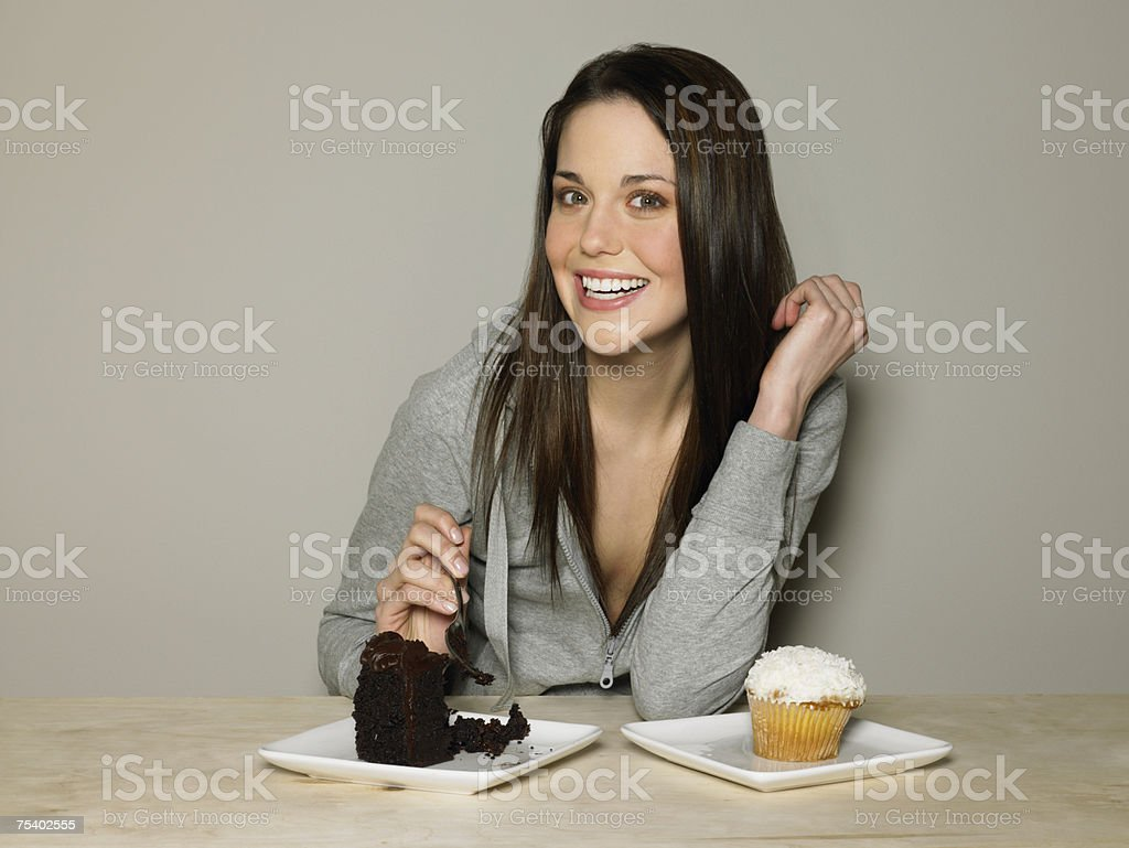 Young woman with cakes royalty-free stock photo