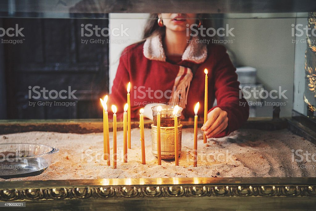 Young woman with candles stock photo