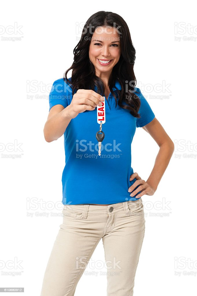 Young Woman with Car Key on White Background stock photo