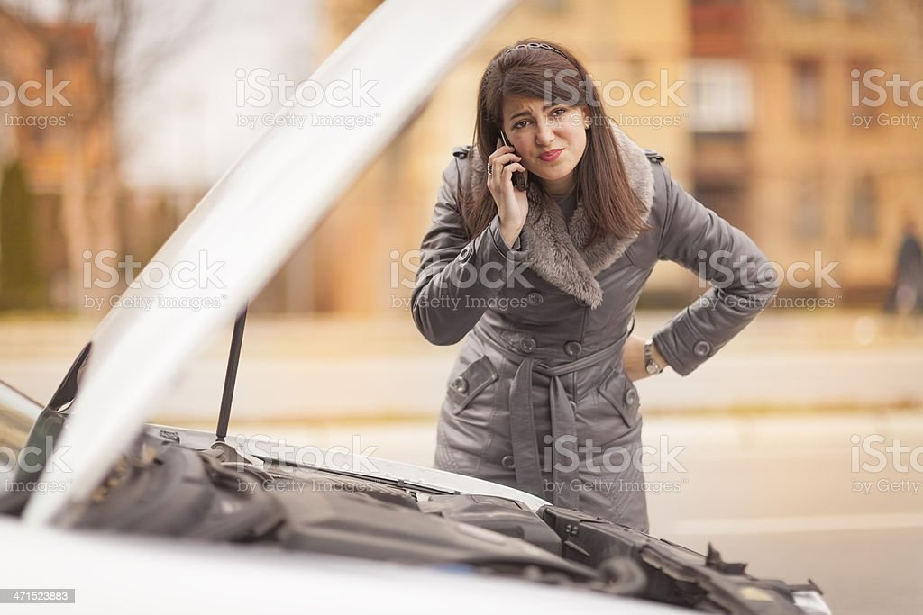 Young woman with car trouble royalty-free stock photo