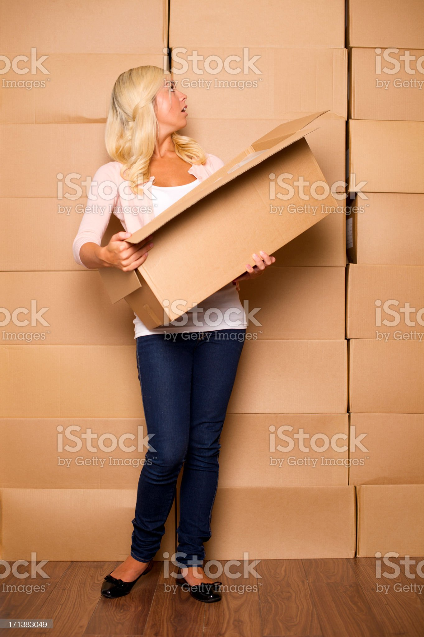 young woman with cardboard boxes royalty-free stock photo