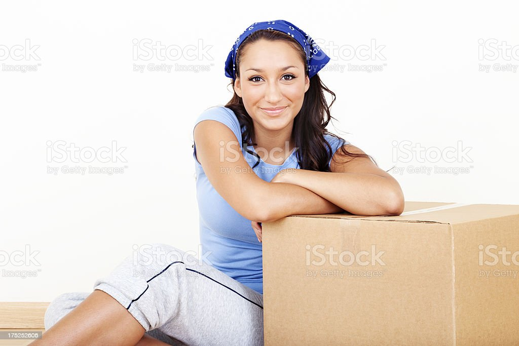 Young Woman with Cardboard Moving Box royalty-free stock photo