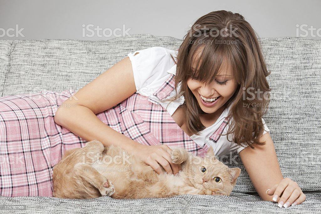 Young woman with cat royalty-free stock photo