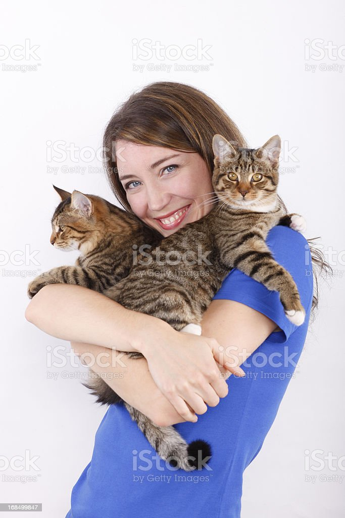 Young woman with cats. stock photo