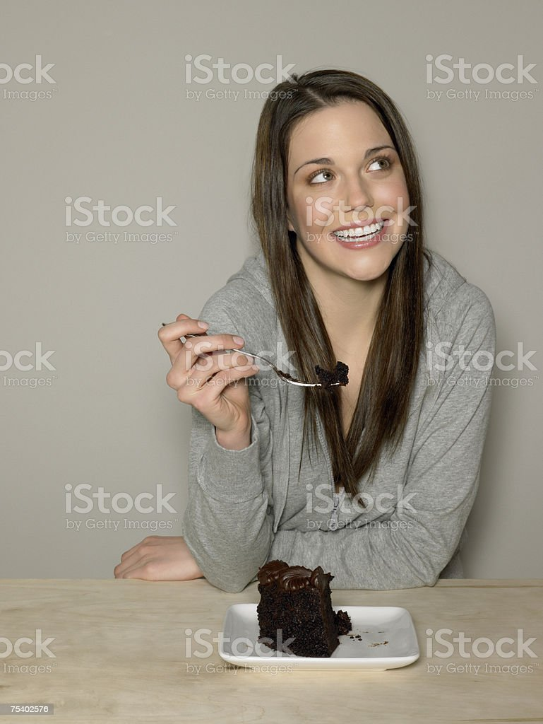 Young woman with chocolate cake royalty-free stock photo