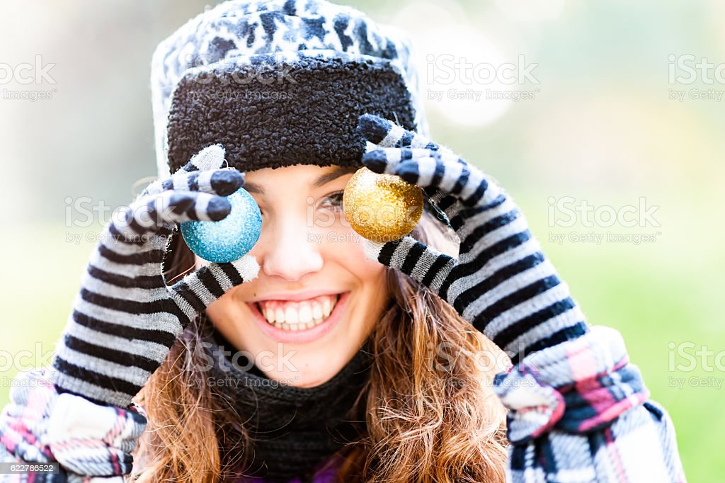 Young woman with Christmas decoration stock photo