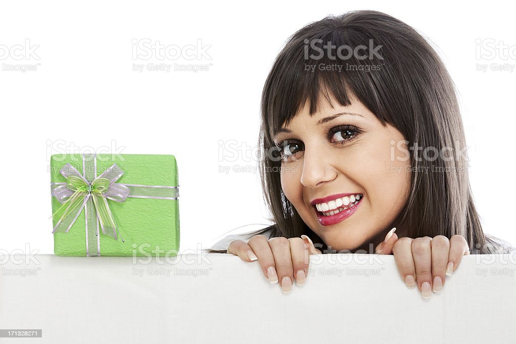 Young woman with christmas gift stock photo