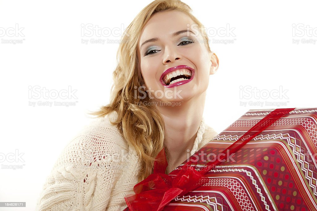Young woman with Christmas gift royalty-free stock photo