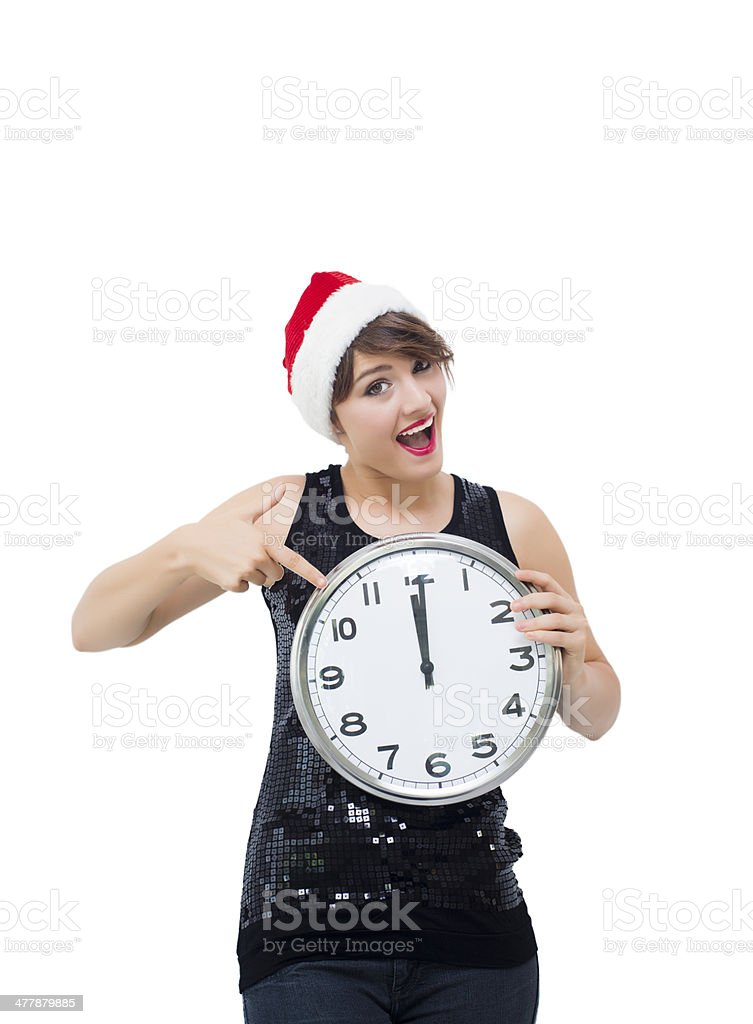 Young woman with christmas hat and clock royalty-free stock photo