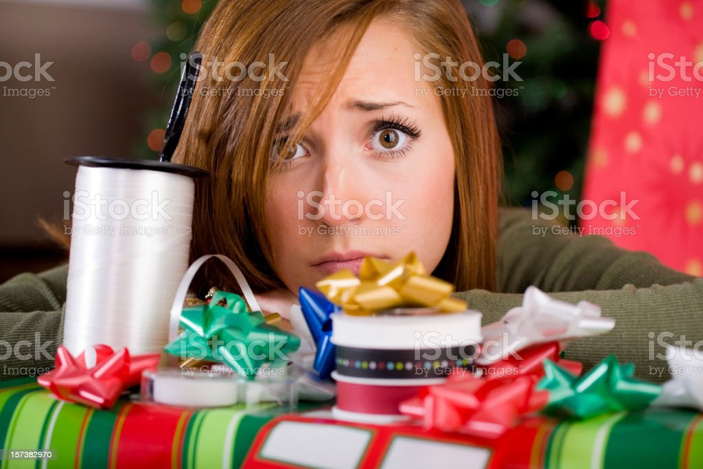 Young Woman with Christmas Present stock photo