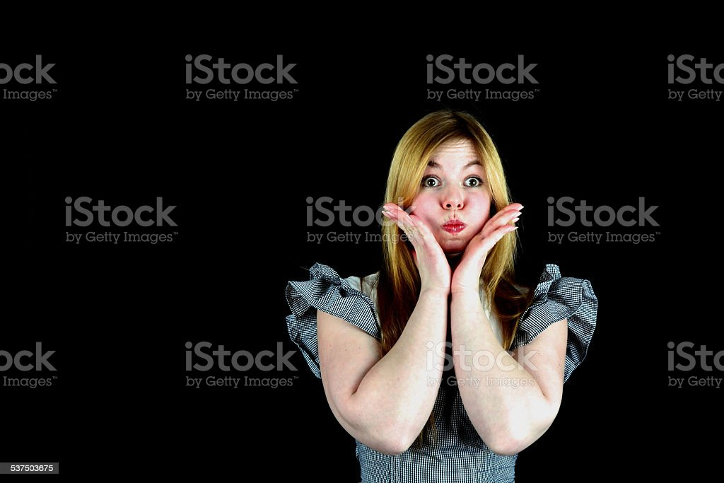 Young woman with chubby cheeks stock photo