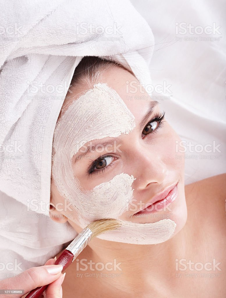 Young woman with clay facial mask stock photo