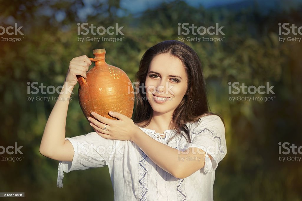 Young Woman with Clay Pitcher stock photo