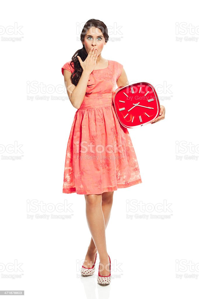 Young woman with clock royalty-free stock photo