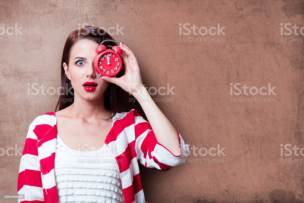 young woman with clock stock photo