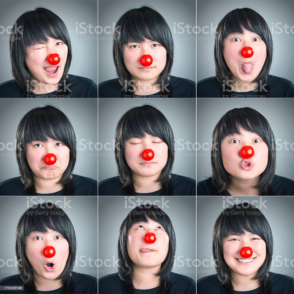 Young woman with clown nose stock photo