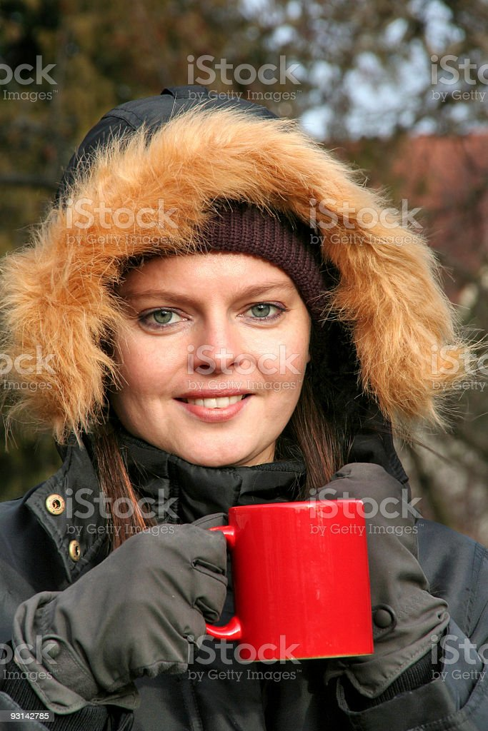 young woman with coffee cup in winter cloth royalty-free stock photo