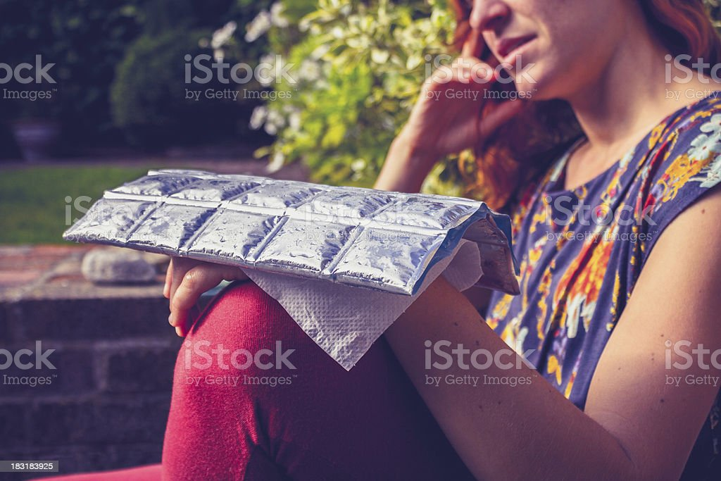 Young woman with cold pack on injured hand royalty-free stock photo
