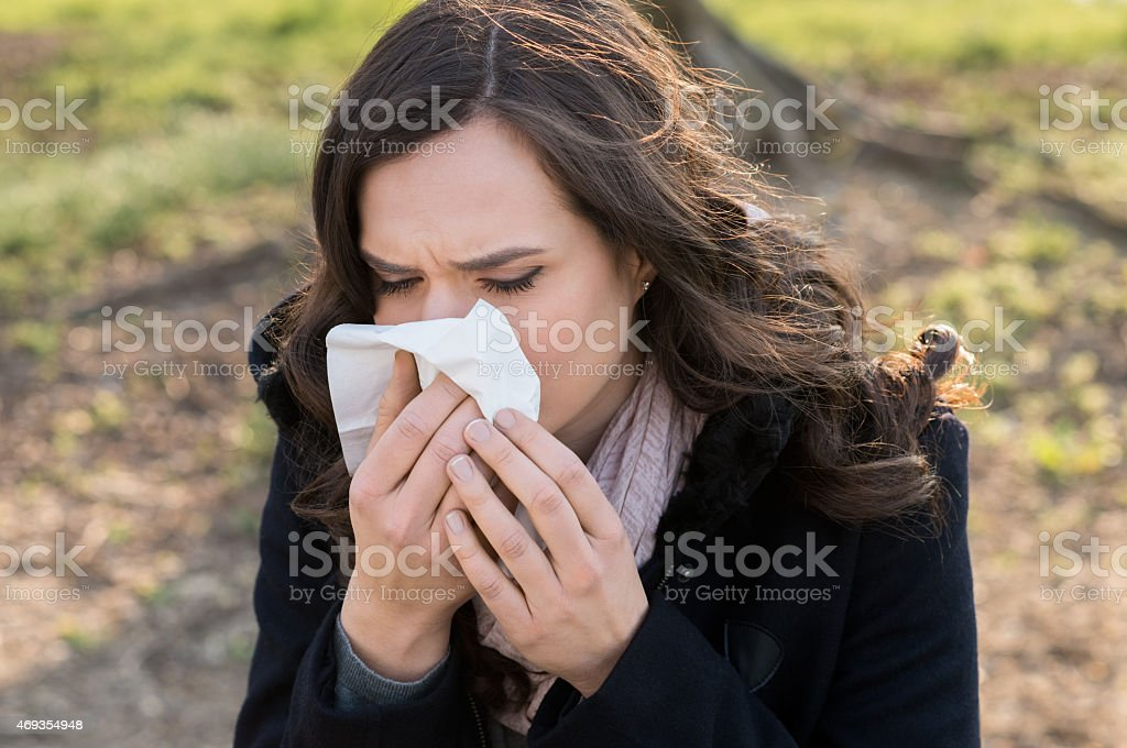 Young woman with cold stock photo