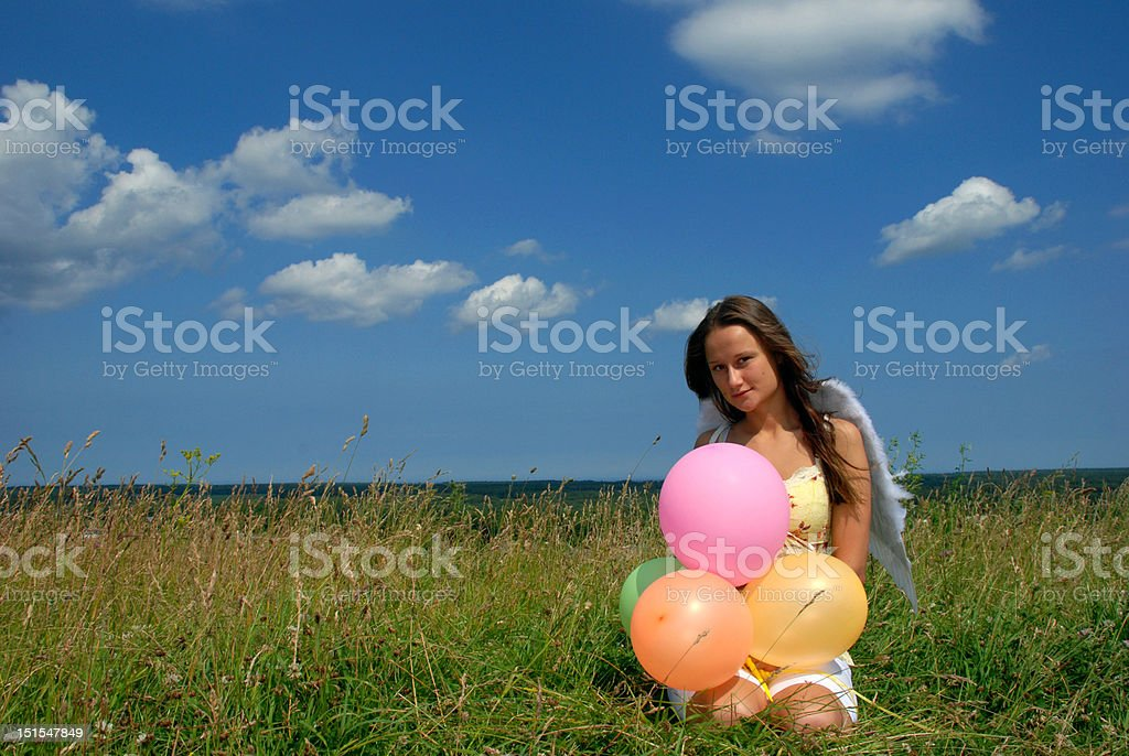 Young woman with colorful balloons royalty-free stock photo