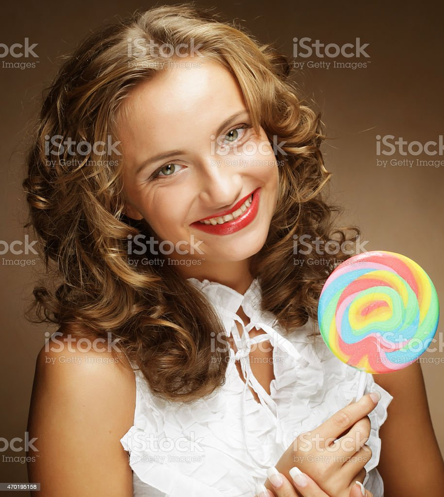 Young woman with colorful lollipop stock photo