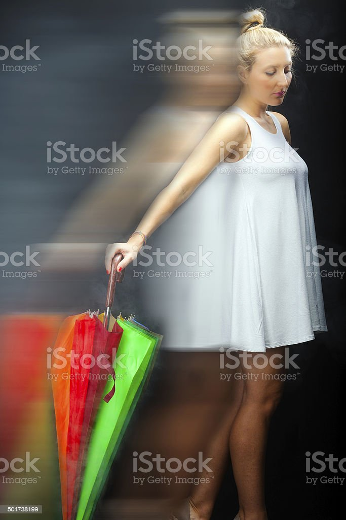 Young woman with colorful umbrella. Color image stock photo