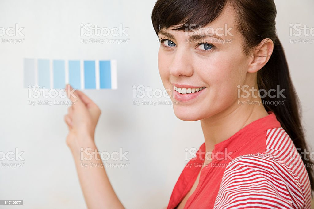 Young woman with colour chart royalty-free stock photo