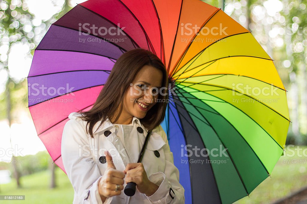 Young woman with colourful umbrella stock photo