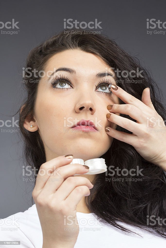 Young woman with contact lense royalty-free stock photo