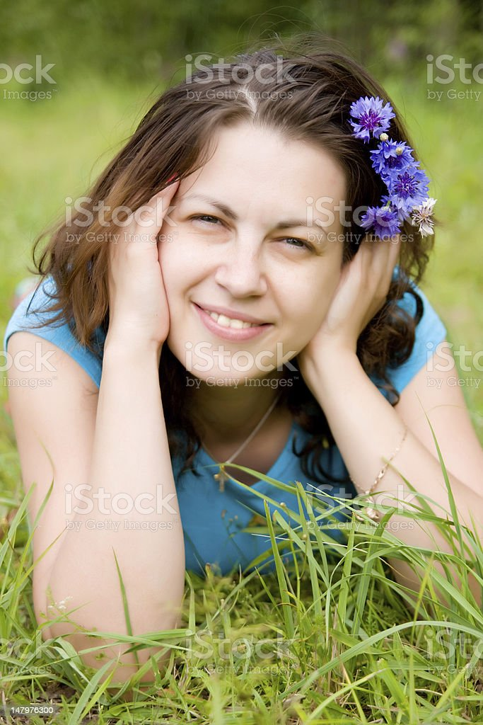 Young woman with cornflowers in hair stock photo