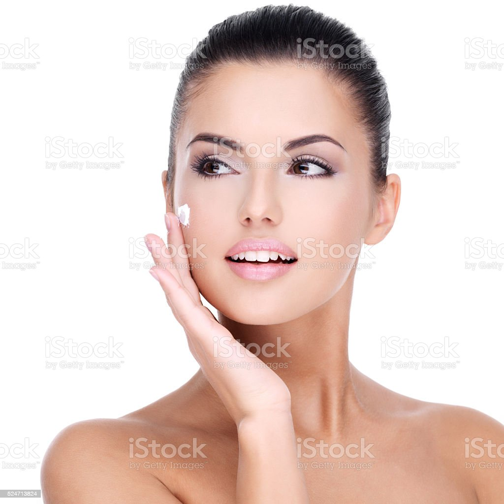 Young woman with cosmetic cream on face stock photo