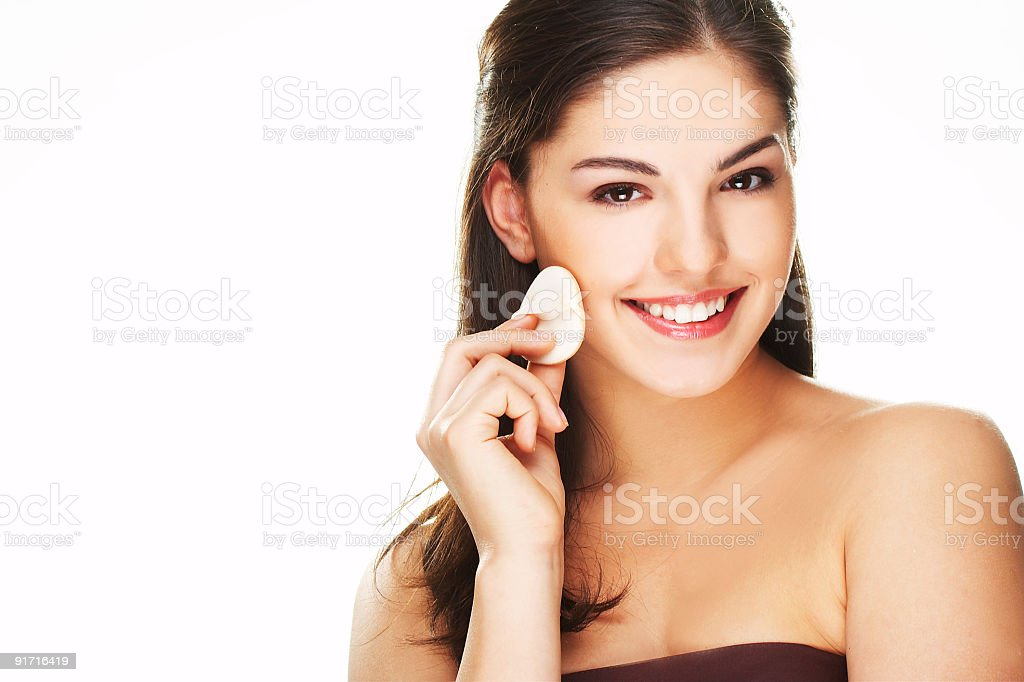 young woman with cosmetic petal royalty-free stock photo
