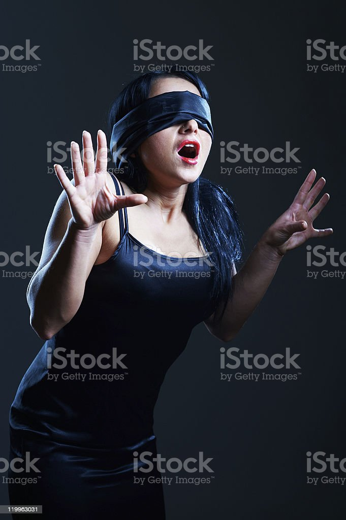 Young woman with covered eyes stock photo