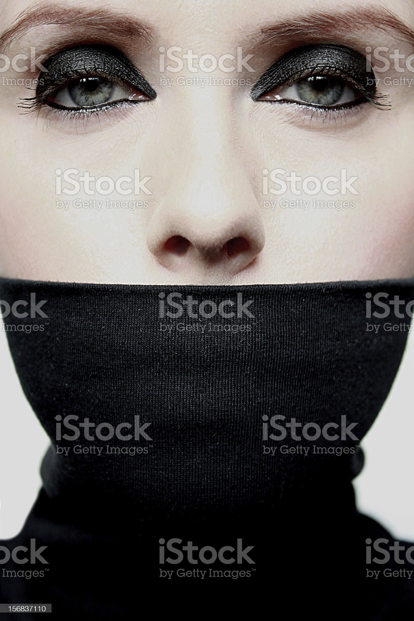 Young woman with covered mouth royalty-free stock photo