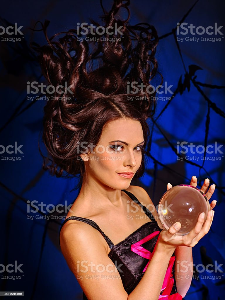 Young woman  with crystal ball stock photo