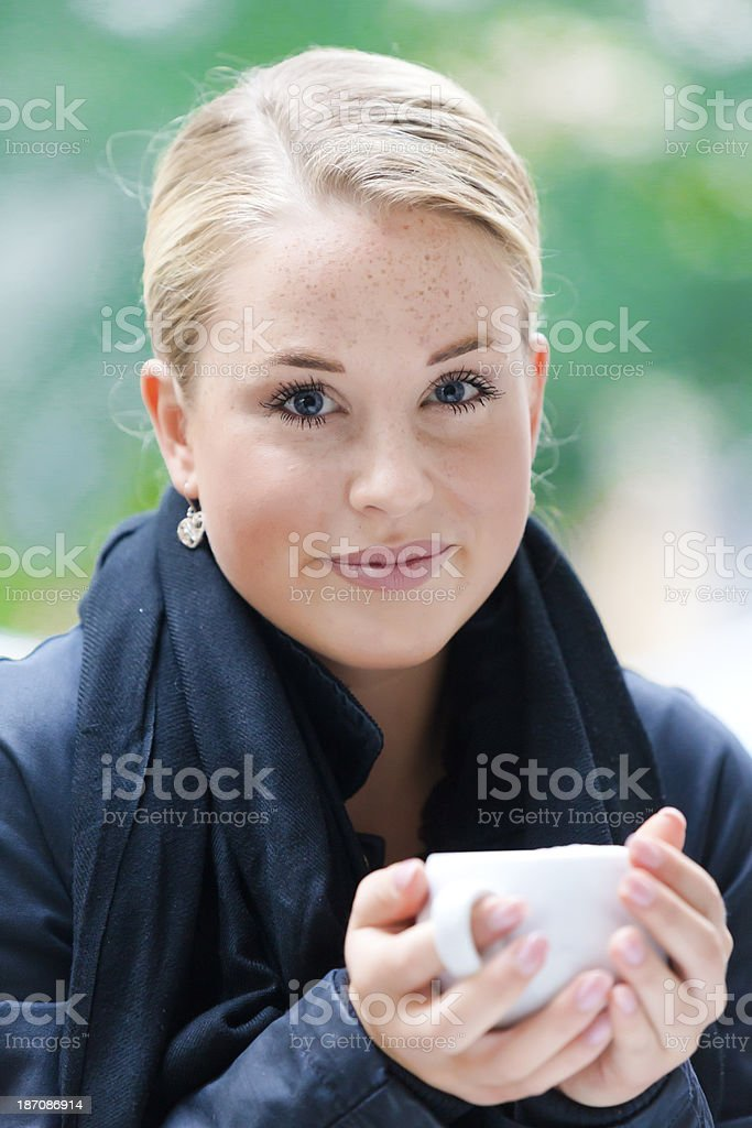 Young woman with cup of coffee ot tea royalty-free stock photo