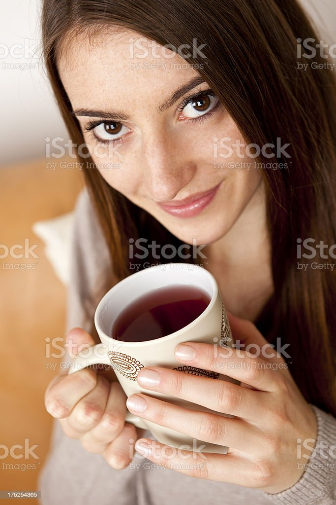 Young woman with cup of tea royalty-free stock photo