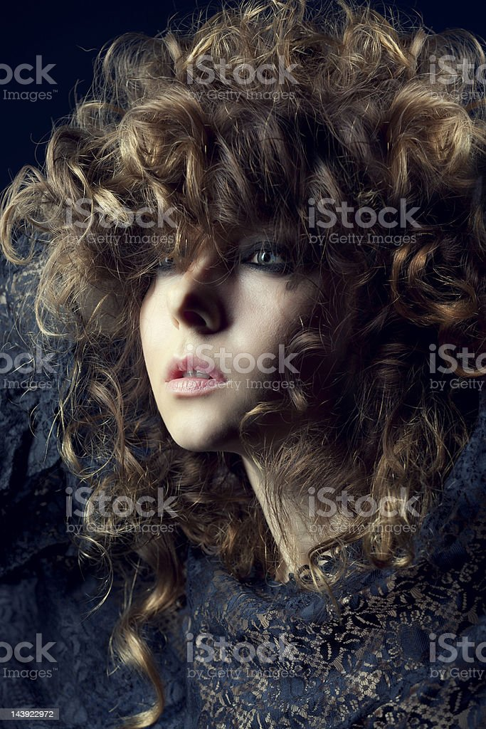 Young woman with curly hair stock photo