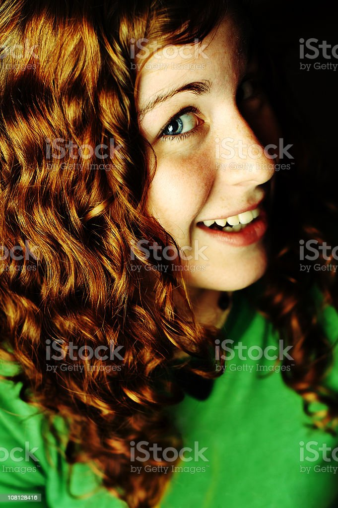 Young Woman With Curly Hair Smiling royalty-free stock photo