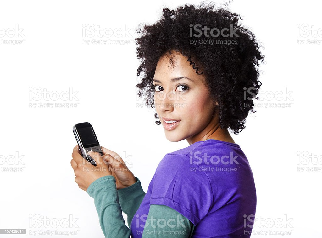 young woman with curly hair texting royalty-free stock photo